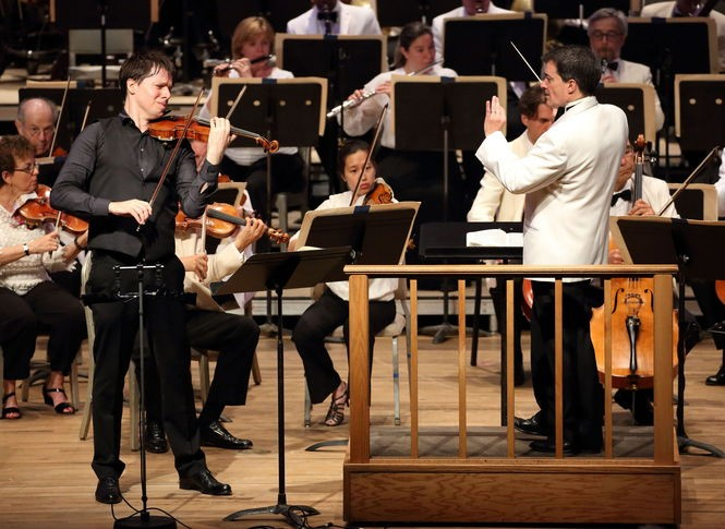 The Boston Symphony Orchestra performs with violinist Joshua Bell and conductor Jacques Lacombe on Friday at Tanglewood in Lenox, Mass.