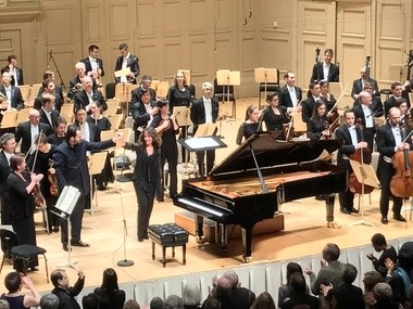Conductor Andris Nelsons, pianist Helene Grimaud and the Boston Symphony Orchestra take a bow after performing Brahms' 1st Piano Concerto at Symphony Hall in Boston on Saturday.