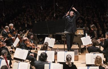 Boston Symphony Orchestra Music Director Andris Nelsons leads French pianist Helene Grimaud in Brahms Piano Concerto No. 2 at Boston's Symphony Hall on Tuesday.