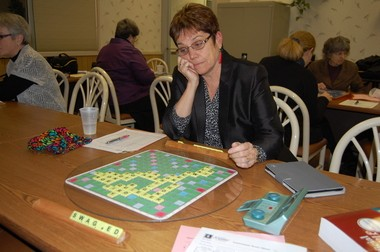 Marilyn Schmidt of Easthampton contemplates her next word in a Scrabble game in the Community Room in the back of Burger King at 344 King St., Northampton.