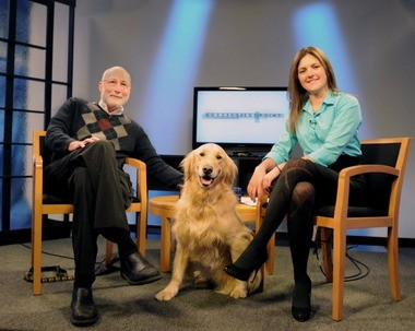 """Carrie Saldo with Theo Chipkin and his master, Robert Chipkin on the """"Connecting Point"""" set."""