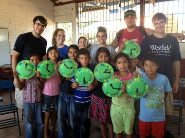 Students from Westfield State University travel to Nicaragua. Here, a classroom photo with fourth-grade students from the Nueva Esperanza Primary School. Back r from left: Patrick Bartel, Kim McShane, Shannon Grossman, Cindy Crawford, Craig Levine and John Bartel.