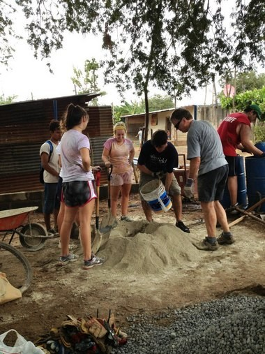 Students from Westfield State University travel to Nicaragua. Here, mixing cement, from left, are Olivia Sheedy, Katelyn Hervol, Donald Alonzo (La Esperanza Granada liason), Deryn Copeland, John Bartel, Peter Kitchen (a volunteer from England) and Craig Levine.