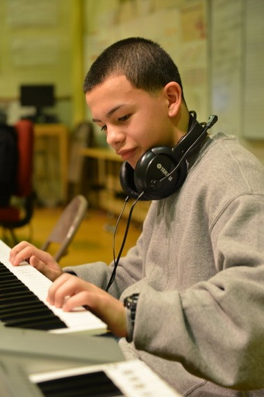 Luis Rivera, a seventh-grader, plays keyboards in music class at Dr. Marcella Kelly School. He is one of the 2013 Rising Stars.