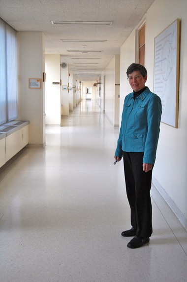 """Sister Maxyne D. Schneider, president of the Sisters of St. Joseph of Springfield, stands in one of the long, bright hallways at Mont Marie, the order's motherhouse in Holyoke. She is overseeing an effort to improve the order's """"dire"""" financial situation. Photo by Cori Urban ABOUT THE SERIES The Sisters of St. Joseph of Springfield, founded in 1883, is confronting a severe financial crisis which could leave the order without cash assets by 2017. This three-part series looks at the history of the order, the financial challenge and profiles some of its members. SUNDAY: The Sisters of St. Joseph of Springfield confronts a financial crisis; a short history of the congregation; also, an op-ed piece by Sister Maxyne D. Schneider, president of the congregation MONDAY: At an age when many of her lay counterparts are retiring, 71-year-old Sister Eleanor M. Spring continues to work, counseling incarcerated women TUESDAY: Sister Carol A. Allan, head of campus ministry at Elms College, which the order founded, is, at 62, among the most junior members of the congregation."""