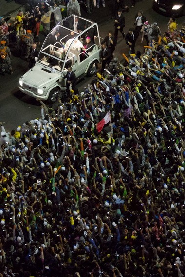 Pope Francis greets people from his popemobile on Copacabana beach in Rio de Janeiro, Brazil, on July 25.