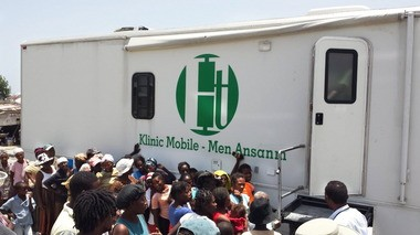 People line up to receive medical care outside a mobile clinic created by the Springfield-based nonprofit, Hands Together, in Cite Soleil, Port-au-Prince, Haiti