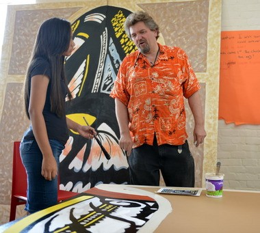 Vitek Kruta of Gateway City Arts, right, works with Gildaly Negron, 16, on art restoration apprenticeship program at his Race Street facility on Aug. 6.