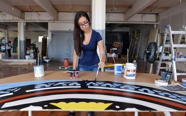 Julie Vazquez, 16, works on the art restoration project at Gateway City Arts in Holyoke Aug. 6.