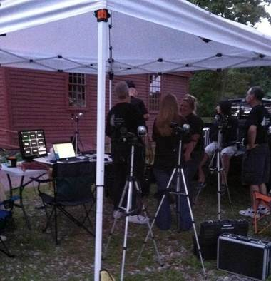 Members of the Agawam Paranormal Society gather with sensing equipment before entering the Thomas Smith House in Agawam.