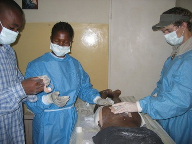 Cade doing wound care at an AIDS hospice in Zambia.