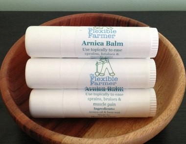 The Flexible Farmer Arnica Balm is made of arnica oil and bees wax and is packaged in a 5-ounce container (similar to that of an oversized lip balm) that can be applied directly to the body. Arnica is an herb that can be used to ease sore muscles, bruises, sprains and strains.