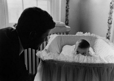 U.S. Sen. John F. Kennedy visits with daughter, Caroline, at their home in Washington, D.C., in this 1958 photo by Ed Clark.