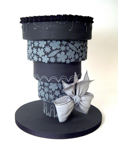 """This undated image released by Charm City Cakes shows an upside-down wedding cake frosted in black, a divorce cake by celebrity chef and baker Duff Goldman from Charm City Cakes in Baltimore, Md. Event planners, bakers, lawyers and academics note the rise of """"divorce parties"""" over the last several years, many with cakes featuring weapon-wielding brides or gloomy black frosting on inverted tiers. Goldman, chef and owner of Charm City Cakes in Baltimore and Charm City Cakes West in Los Angeles, said he has been creating divorce cakes for a decade, with one or so orders a month nowadays. (AP Photo/Charm City Cakes)"""
