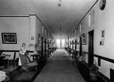 "A 1930s view of a female ward on the south side of ""Old Main"" at Northampton State Hospital. More than any other ward, this maintained the quality and feeling of the original building and all of its details."