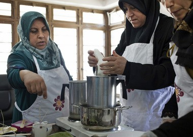Women make candles in Iraq. Prosperity Candle, now located in the Eastworks building in Easthampton, produces and sells a variety of candles in handcrafted, fair trade containers handmade by women in more than a dozen countries.