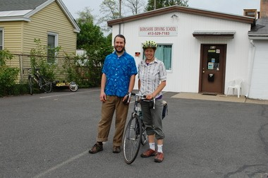 Brett I. Constantine, one of the Pedal People instructors (left), and Ruthy M. Woodring, a worker-owner of Pedal People Cooperative, stand outside Berkshire Driving School in Easthampton, during a presentation on sharing the road.