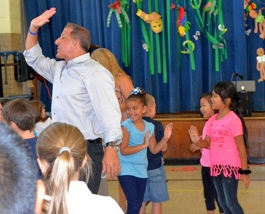 Local businessman Paul DiGrigoli dances with students at Memorial Elementary School in West Springfield. (Submitted Photo)