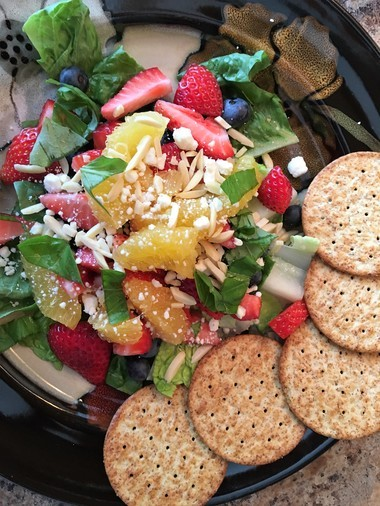 Fruit salad with whole grain crackers is a healthy choice.