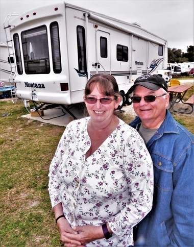 Richard and Carolyn Berthiaume of Westfield stand beside their fifth-wheel trailer late last month at Jetty Park Campground, Port Canaveral, Florida. Retirement has made it possible for the Berthiaumes to spend winter touring the South.