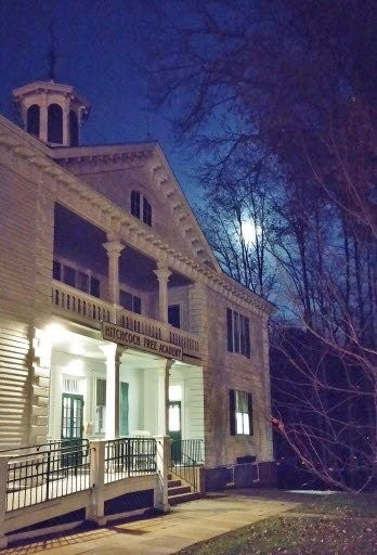 A full moon illuminates the night over Hitchcock Free Academy in Brimfield, which offers many different classes throughout the year.