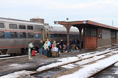 Springfield passengers prepare to board the Lake Shore Limited Amtrak train bound for Boston in December 2013.