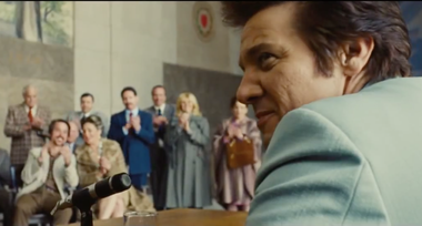 """Jeremy Renner speaks at the Worcester Memorial Auditorium in a scene from the trailer for """"American Hustle."""""""