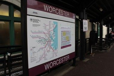 The MBTA commuter rail sign and scheduled posted on the platform at Union Station, Worcester.