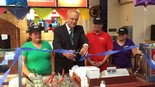 Worcester Mayor Joseph Petty cuts the ceremonial ribbon at Taco Mexico, which is located in the Greendale Mall. With the mayor are (from left) Maria, Jose (owner), and Leticia Zuniga.