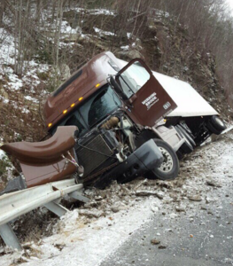 Truck falling on its side on Mass  Pike in Brimfield closes one lane