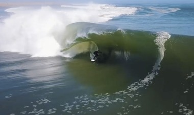 In this image made from video provided by Chris Rogers, surfer Koa Smith rides a wave off the coast of Namibia, on the Western shore of Africa. (Chris Rogers via AP)
