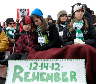 People listen to speaker during a rally against gun violence near the Washington Monument in Washington, D.C., on Jan. 26.