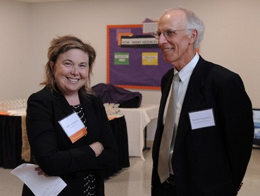 Beth Anderson, founder and CEO of the Phoenix Academy Charter School chats with Dennis Fitzpatrizk of The O'Connell Companies before the formal ribbon cutting at the Springfield School on Wednesday September 30, 2015