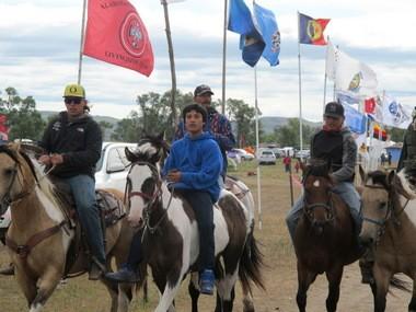 Horseback riders make their way through an encampment near North Dakota's Standing Rock Sioux reservation on Friday, Sept. 9, 2016.