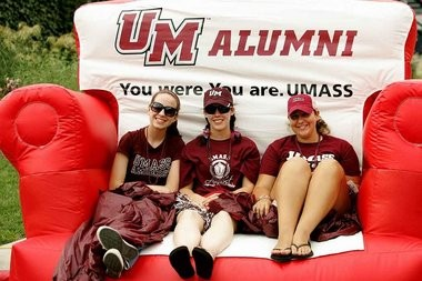 UMass students Emma Mulvaney ,Melissa Tarbell and Kall Ackerman were selected to sit in the Big Chair during its debut at Gillette Stadium on Sept. 8. photo by J. Anthony Roberts