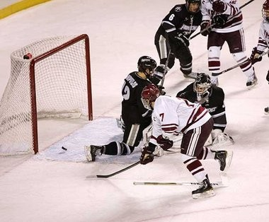 Jon Gillies, pictured here on Jan. 12 making a stop on UMass defenseman Darren Rowe, stopped all 44 UMass shots on Jan. 13.