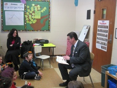 """Springfield Mayor Domenic Sarno reads to students at Lubavitcher Yeshiva Academy as part of its """"Community Connections"""" day, in this March 8, 2011 file photo."""