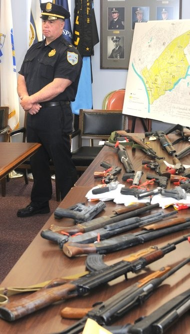 In this 2009 Republican file photo, Springfield Police showcase a number of guns taken off the streets as the city was reeling from three murders in a relatively short period of time.