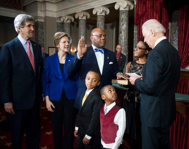 """Vice President Joe Biden re-enacts administering the Senate oath to Sen. William """"Mo"""" Cowan, D-Mass. Thursday, Feb. 7, 2013, on Capitol Hill in Washington. Joining him, from left are. Secretary of State John Kerry, who he is replacing, Sen. Elizabeth Warren, D-Mass., his sons Miles, 8, and Grant 4, and his wife Stacey. (AP Photo/Kevin Wolf)"""