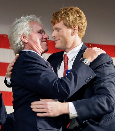 In this photo taken Jan. 7, 2010 photo, former Massachusetts Rep. Joseph P. Kennedy II, left, hugs his son, Joseph P. Kennedy III. Joe Kennedy II, a son of the late Sen. Robert Kennedy and nephew of President John F. Kennedy, founded Citizens Energy in 1979 with the goal of reducing home heating oil costs for the poor and elderly after the energy crisis of the 1970s. The group worked with Chavez since 2005. (AP Photo/Elise Amendola)