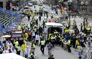 In this April 15 file photo, medical workers help injured people at the finish line of the 2013 Boston Marathon following the bombings in Boston.