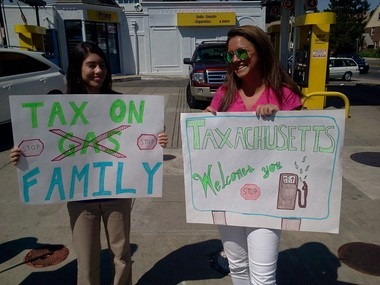 Hannah Orrall, 18, left of Lakeville, and Julia Cotrone, 24, of Hanover, held signs to mark the increase in the state's gas tax during a protest by Republicans at AL Prime Gas Station in Boston.