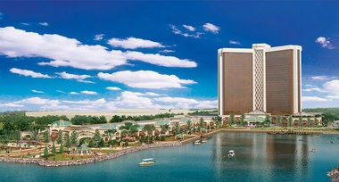 This artist's rendering released Wednesday, March 27, 2013 by Wynn Resorts shows a proposed resort casino on the banks of the Mystic River in Everett, Mass. Las Vegas casino operator Steve Wynn is proposing the complex on 37 acres of land at the site of a former chemical plant. (AP Photo/Wynn Resorts)