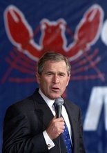 George W. Bush, then a Republican presidential candidate and Texas governor, speaks during a campaign rally at the Bangor International Airport in Bangor, Maine, Friday, Oct. 20, 2000. (AP Photo/Eric Gay)