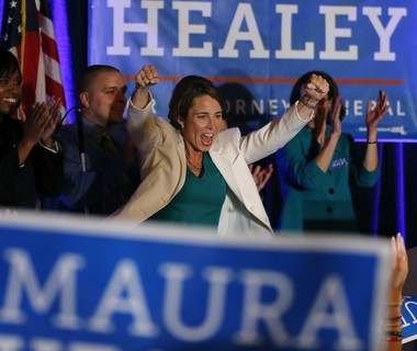 Massachusetts Democratic candidate for attorney general, Maura Healey celebrates as she claims victory in the primary election, Tuesday, Sept. 9, 2014, in Boston. Healey, a former state prosecutor seeking to become the first openly gay attorney general in the nation, captured the Democratic nomination for attorney general on Tuesday following a primary race against a veteran state lawmaker. (AP Photo/Elise Amendola)