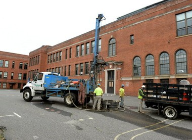 Workers from Seaboard Geotechnical Enviromental Drilling perform soil testing at the site of the former Howard Street School, which will be the MGM Springfield parking garage used for their project.