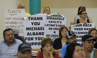 Opponents of a plan to relocate an alcohol correctional center run by Hampden County Sheriff Mike Ashe to Springfield's North End show their support for Mike Albano, the former Springfield mayor who came to their aid to fight the proposal, which is now the subject of a lawsuit.
