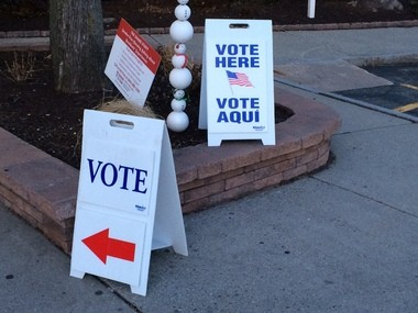 Signs at Baystate Place in the North End of Springfield beckon voters for the Presidential Primary.