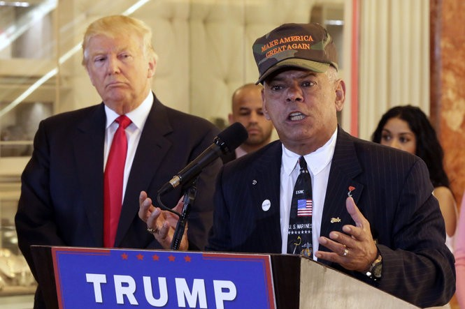 Republican presidential candidate Donald Trump listens at left as Al Baldasaro, a New Hampshire state representative, speaks during a news conference in New York, Tuesday, May 31, 2016. (AP Photo/Richard Drew)