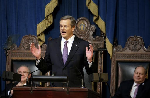 Massachusetts Republican Gov. Charlie Baker, center. (AP Photo/Steven Senne)